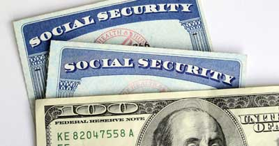 social security cards and one hundred dollar bill