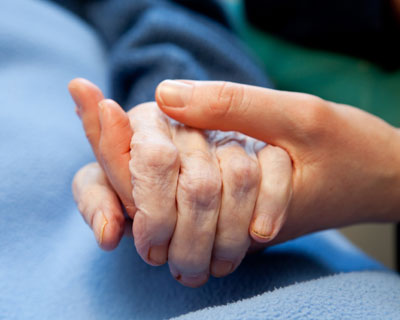 Hospice Care Holding Hand