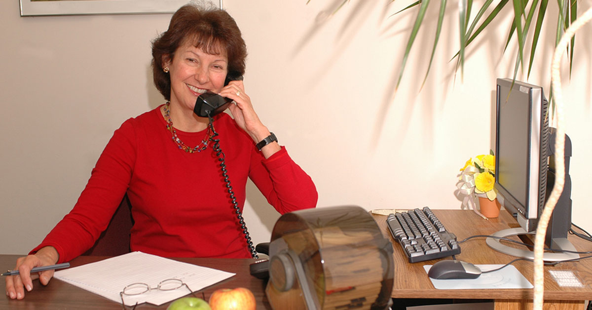 Social worker in her office on telephone
