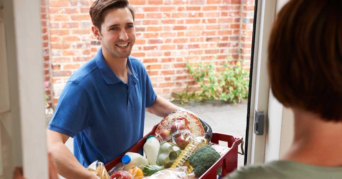 Elderly couple preparing home delivered meal